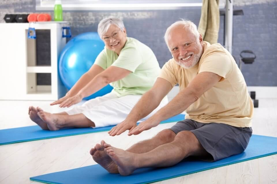 elderly-couple-stretching